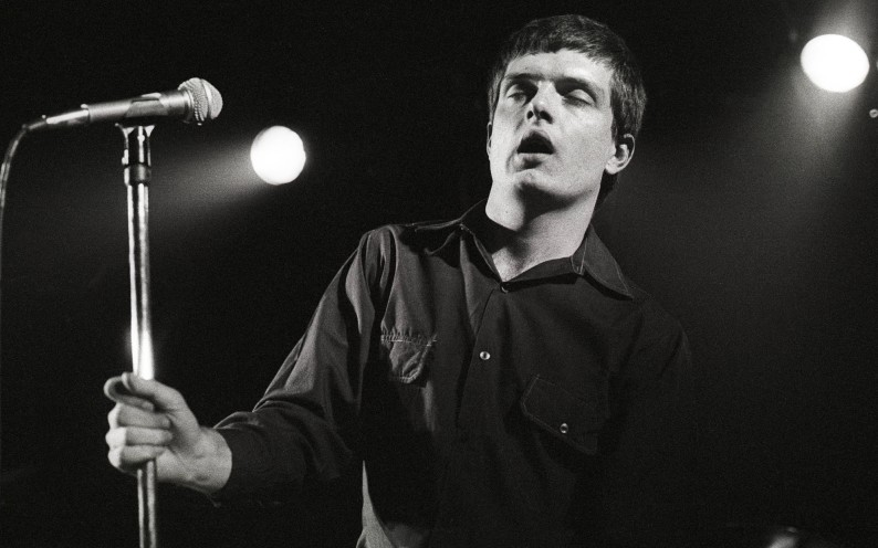 NETHERLANDS - JANUARY 16:  ROTTERDAM  Photo of Joy Division, Ian Curtis performing live onstage at the Lantaren  (Photo by Rob Verhorst/Redferns)
